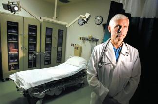 Dr. Larry Foreman treats injured ATV riders at the Arroyo Grande Community Hospital.