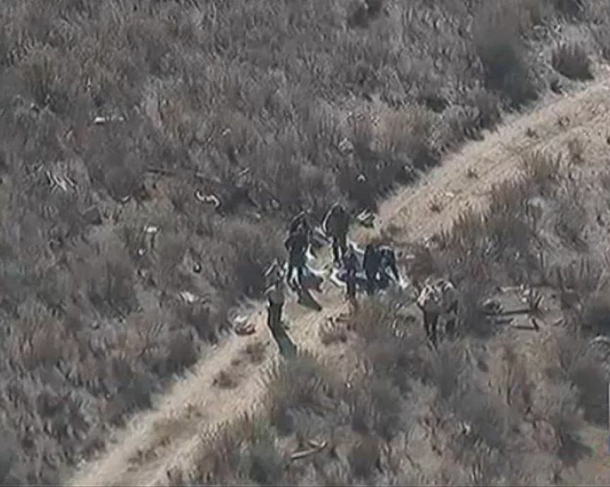 Investigators review the wreckage of a helicopter crash that killed 3 during filming of a TV reality show on a ranch north of Los Angeles on Feb. 10, 2013.