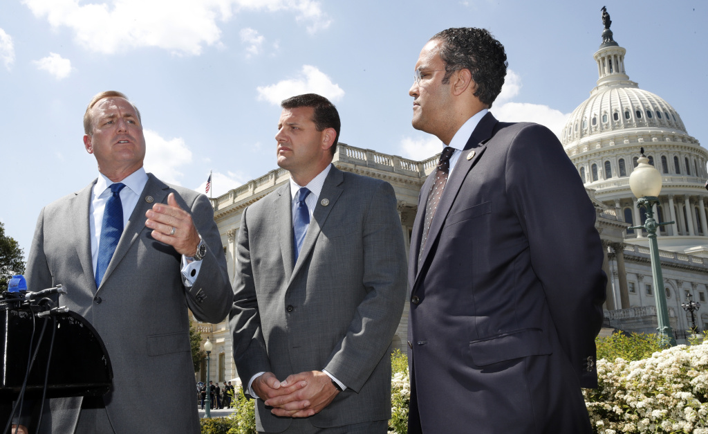 Rep. Jeff Denham, R-Calif., left, speaks next to Rep. David Valadao, R-Calif., and Rep. Will Hurd, R-Texas, during a May 9, 2018 news conference on a discharge petition to force votes on immigration legislation.