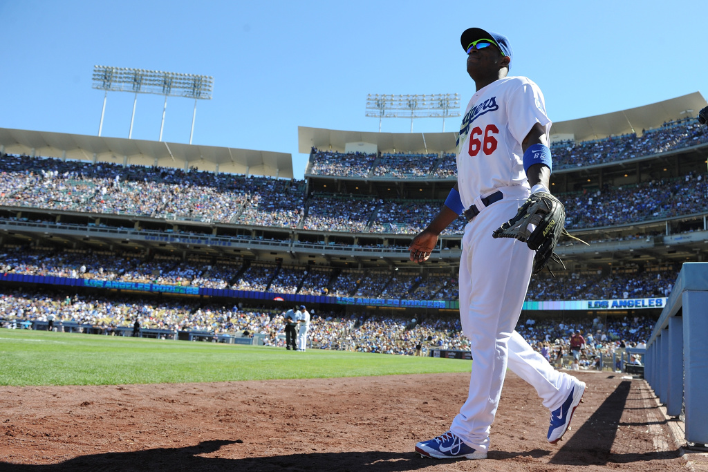 LOS ANGELES, CA - SEPTEMBER 29:  Yasiel Puig #66 of the Los Angeles Dodgers walks onto the field to start the game against the Colorado Rockies at Dodger Stadium on September 29, 2013 in Los Angeles, California.  (Photo by Lisa Blumenfeld/Getty Images)