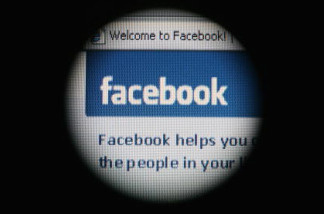 In this photo illustration the social networking site Facebook is displayed on a laptop screen.