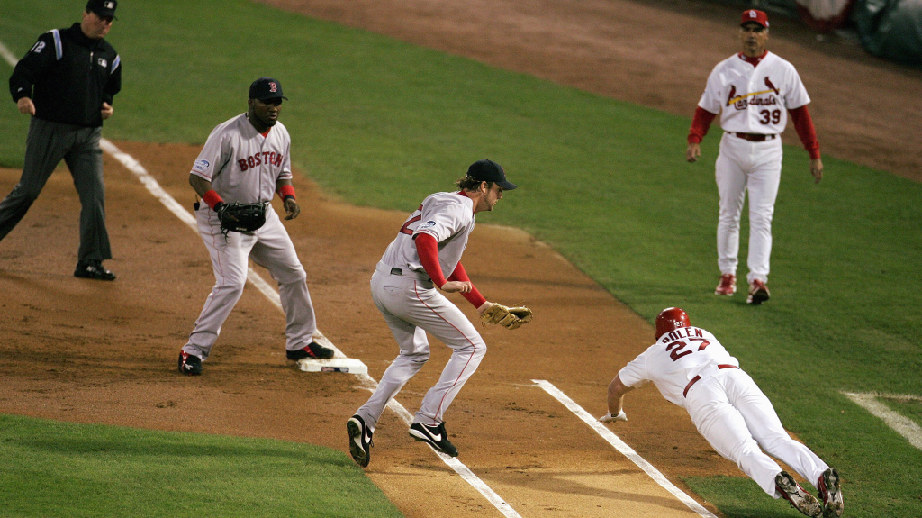 Boston Red Sox slugger David Ortiz, a designated hitter in American League ballparks, played first base in St. Louis during the 2004 World Series. He'll do the same for Game 3 of the series Saturday.