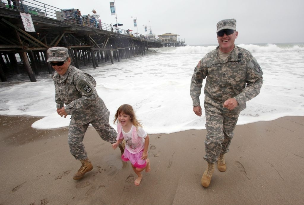 First Sergeant Tim McCoy, wife Amy, and daughter Sami in Santa Monica. This shoot was for HeartsAprart.org.