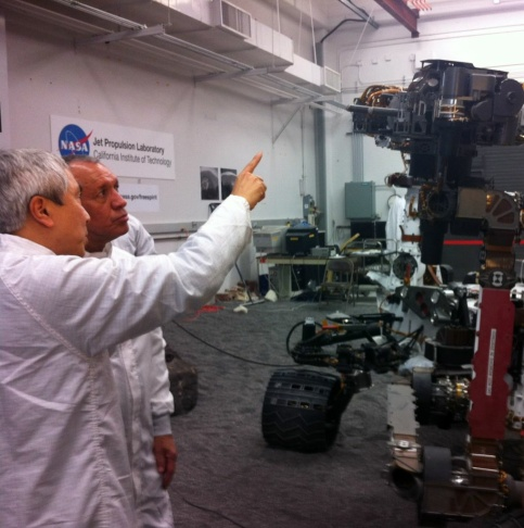 NASA Director Charles Bolden tours JPL in Pasadena with JPL scientist Fuk Li. NASA is slated to cut their budget by $300 million.