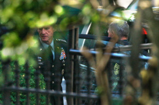 Gen. Stanley McChrystal (L), the top commander of the U.S. Force in Afghanistan, arrives at the White House for a meeting with U.S. President Barack Obama June 23, 2010 in Washington, DC.