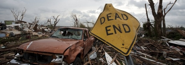 A storm-damaged sign stands in a neighborhood after a massive tornado passed through the town killing more than 120 people on May 25, 2011 in Joplin, Missouri.