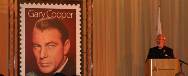 Leonard Maltin welcomes visitors to the U.S. Postal Service's Gary Cooper Commemorative Stamp unveiling at the Autry National Center in Los Angeles.