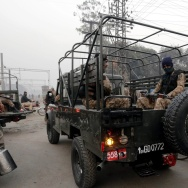Pakistani army soldiers patrol near the Kot Lakhpat Central Jail in Lahore as security has been increased to high alert after government lifted a six-year moratorium on executions.