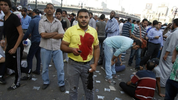 A pro-Morsi supporter stands with other demonstrators in Cairo's Abbassiya neighborhood on Friday.