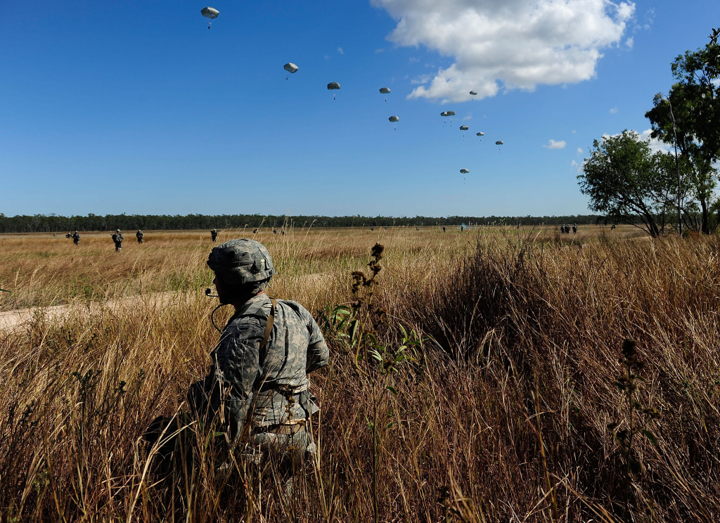 A U.S Paratrooper from 4/25th Infantry Division looks on as other members of his unit make a jump from a C-17 Globemaster as part of exercise Talisman Sabre on July 8, 2015.