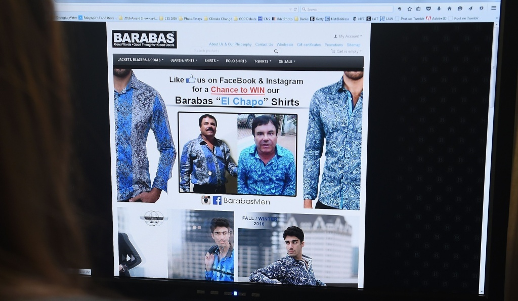 A woman looks at the homepage of the clothing house Barabas on Tuesday. At the time, the site featured two photos of Mexican drug kingpin Joaquin