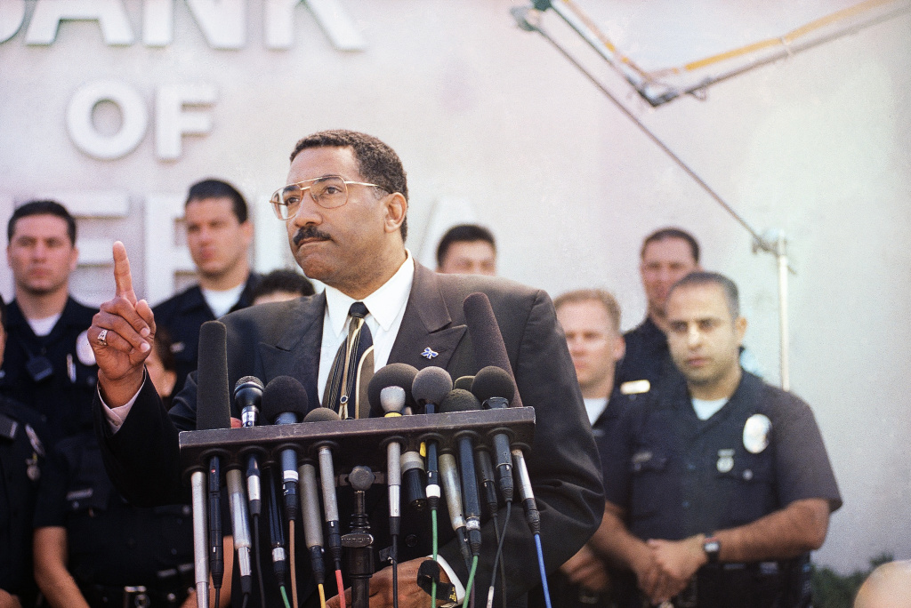 File: Los Angeles Police Chief Willie Williams answers reporters questions during a news conference in front of the bullet scarred Bank of America in the North Hollywood section of the city in Los Angeles on Saturday, March 1, 1997, following a wild shootout through local streets that started as the bank was being robbed. Williams was the first African-American police chief in both Philadelphia and Los Angeles. He took over from LAPD Chief Daryl Gates following the 1992 riots.