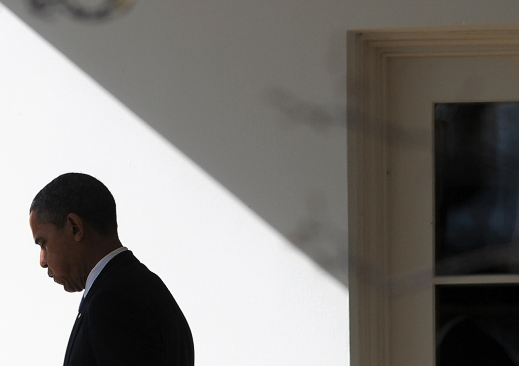 President Barack Obama walks out of the Oval Office to board the Marine One helicopter to leave the White House in Washington, DC, on Febraury 23, 2012 en route to Miami, Florida.