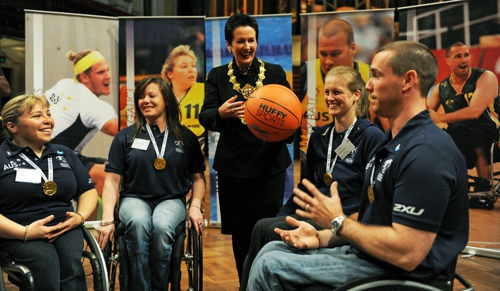 Sydney Lord Mayor Clover Moore throws a basketball as she is joined by members of the 2012 Australian Paralympic team.