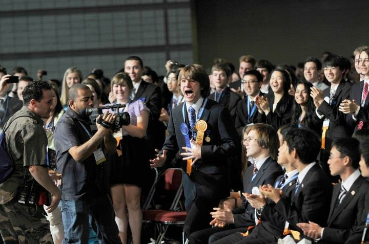 Jack Andraka (center) moments after it was announced that he won the Gordon E. Moore Award and $75,000 prize at the 2012 Intel International Science and Engineering Fair in Pittsburgh, Pennsylvania held in May.