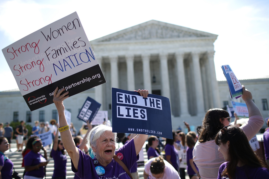 Supporters of women's rights protest outside the U.S. Supreme Court as the court issues a ruling on a California law related to abortion issues on June 26, 2018 in Washington, DC.