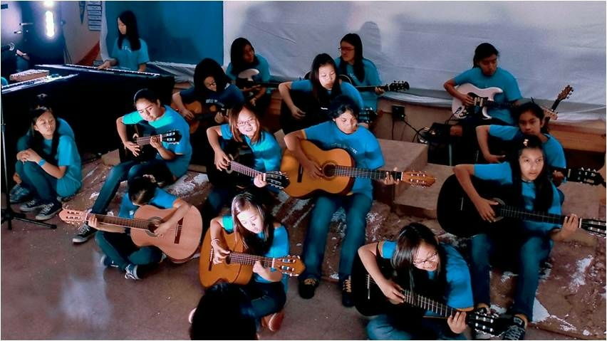 Students play guitars