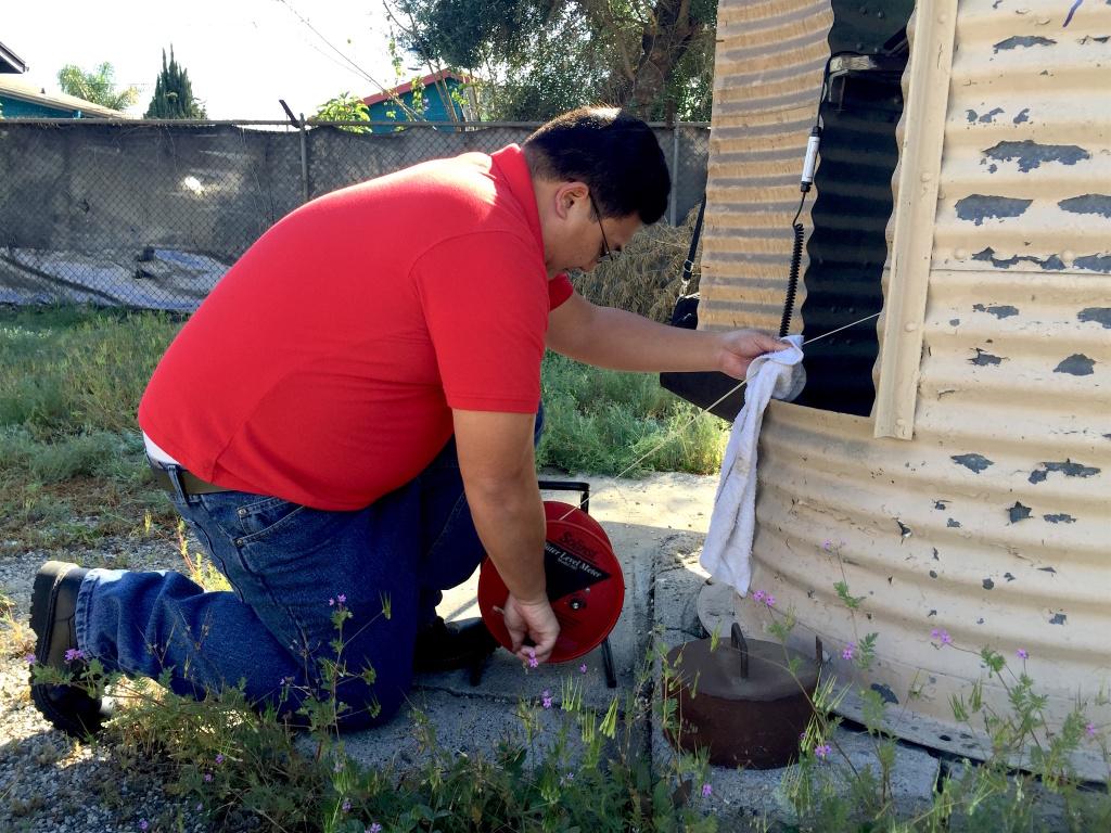 "Tuan Nguyen checks the groundwater level at the Main San Gabriel Basin's ""key well"" in Baldwin Park, CA."