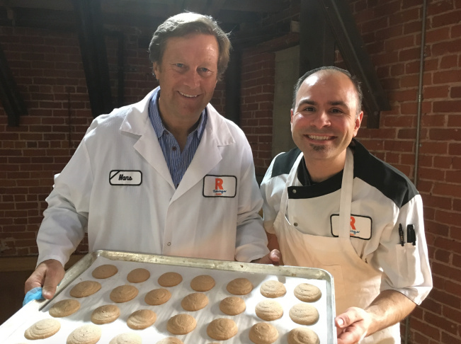 Hans Rockenwagner, owner of the Rockenwagner Bakery in Los Angeles, and corporate pastry chef Anthony Nigro hold a tray of pfeffernusse cookies just out of the oven. The cookies are a holiday tradition in Germany and other parts of Europe. In the United States, National Pfeffernusse Day on Dec. 23 celebrates the spice-laden cookie, which likely made its way across the Atlantic long ago with German immigrants.