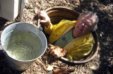 TreePeople's Jim Hardie goes down into an access tube next to the groups' cistern in Coldwater Canyon Park. The cistern holds more than 200,000 gallons of water - enough for outdoor operations the rest of the year.