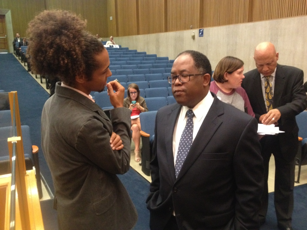 LA County Supervisor Mark Ridley-Thomas, right, speaks with Mark-Anthony Johnson of Dignity and Power Now, a group lobbying for more power for a new Civilian Oversight Commission at the Sheriff's Department.