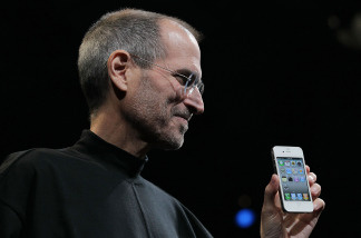 Apple CEO Steve Jobs holds the new iPhone 4 after he delivered the opening keynote address at the 2010 Apple World Wide Developers conference June 7, 2010 in San Francisco, California.