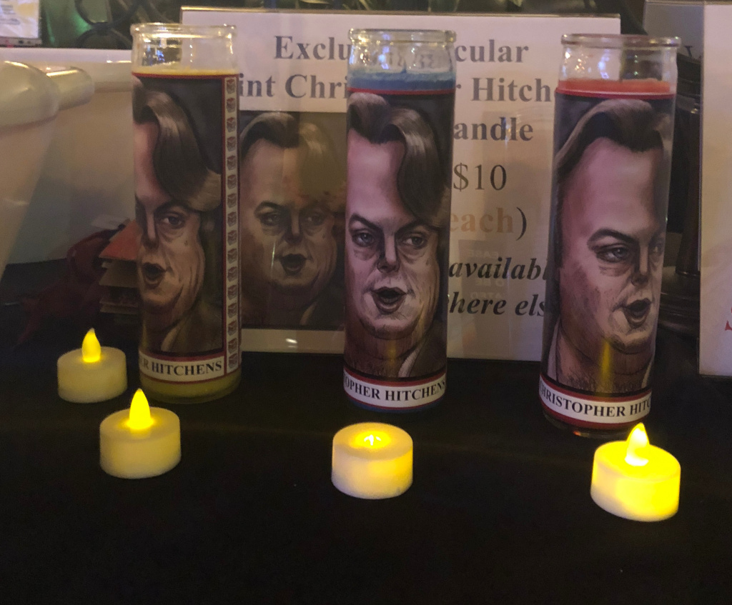 "Votive candles for ""secular saints"" like author and social critic Christopher Hitchens were on display at the first"