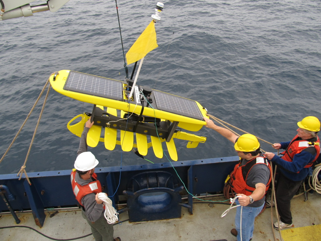 A wave glider is deployed offshore during a Scripps pilot project in 2013 to see if the instrument could replace expensive ocean cables or a mooring to provide real-time data access to scientists onshore.