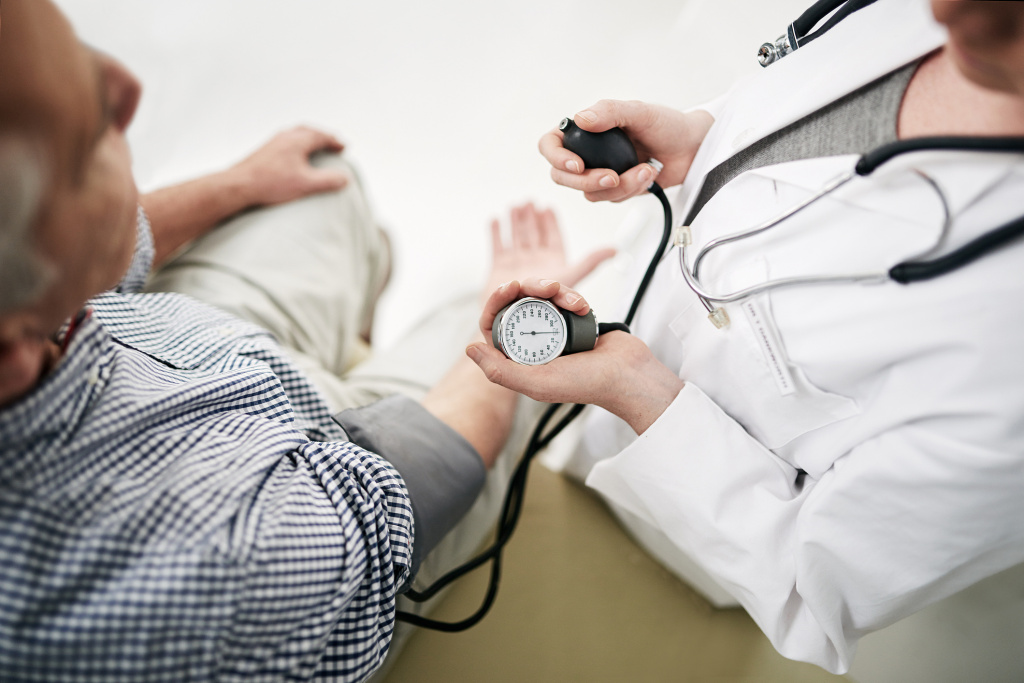 Doctor with a patient taking blood pressure