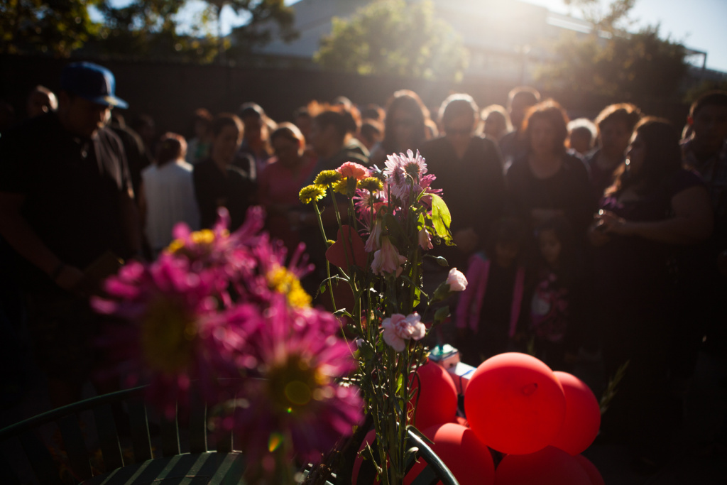 People gather at a memorial outside of the Santa Monica City College library to remember victims of the recent shooting.