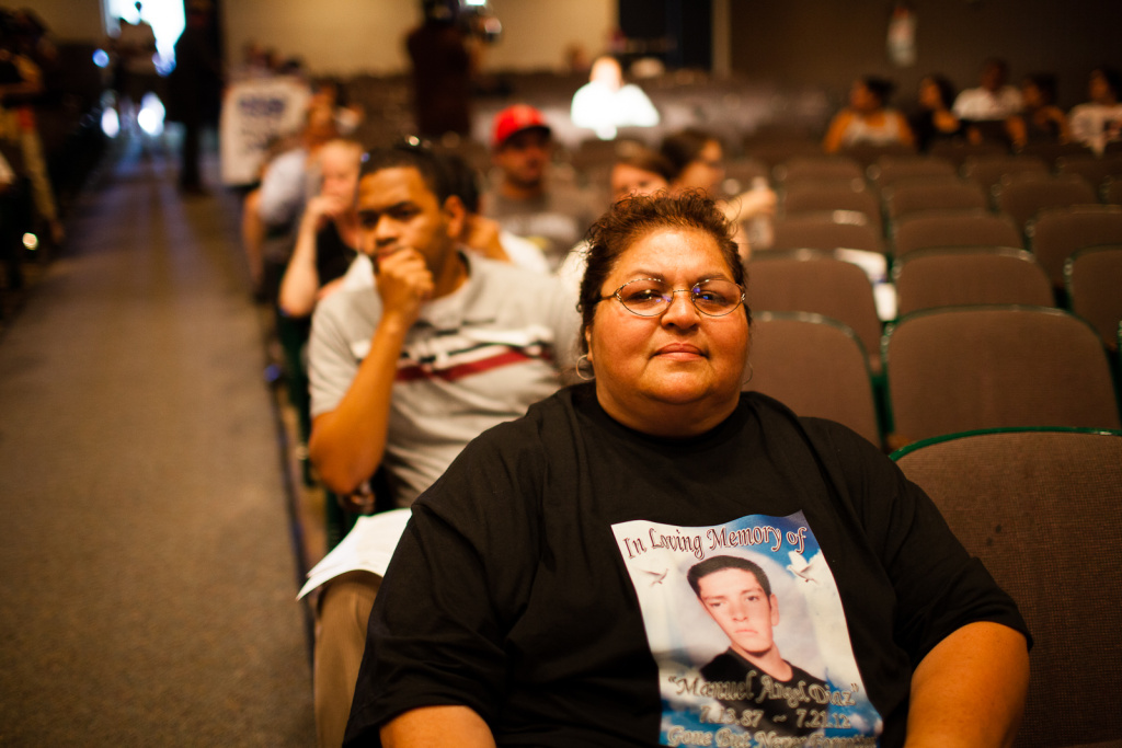 Orange County prosecutors Tuesday said an Anaheim police officer was legally justified when he shot and killed Joel Acevedo, 22, last year. The shooting of Acevedo and Manuel Diaz sparked violent protests in the city. (File photo: Genevieve Huizar, mother of Manuel Diaz, waits to speak at the Anaheim City Council meeting on August 8, 2012. After an unarmed Diaz was killed by Anaheim police in July, the community erupted in protest).