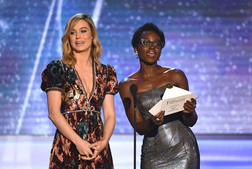 Brie Larson (L) and Lupita Nyong'o present the award for outstanding performance by a cast in a motion picture during the 24th Annual Screen Actors Guild Awards show at The Shrine Auditorium on January 21, 2018 in Los Angeles, California.