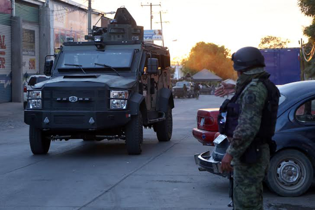 Mexican marines and soldiers guard the surroundings of the morgue where the alleged corpse of Nazario Moreno aka 'El Chayo', the leader of 'Los Caballeros Templarios' drug cartel, remains in Apatzingan, Michoacan, Mexico on March 9, 2014. Mexican drug lord Nazario Moreno, who operated in the region of Michoacan (west), was killed Sunday morning in a confrontation in spite of being considered officially dead since 2010.