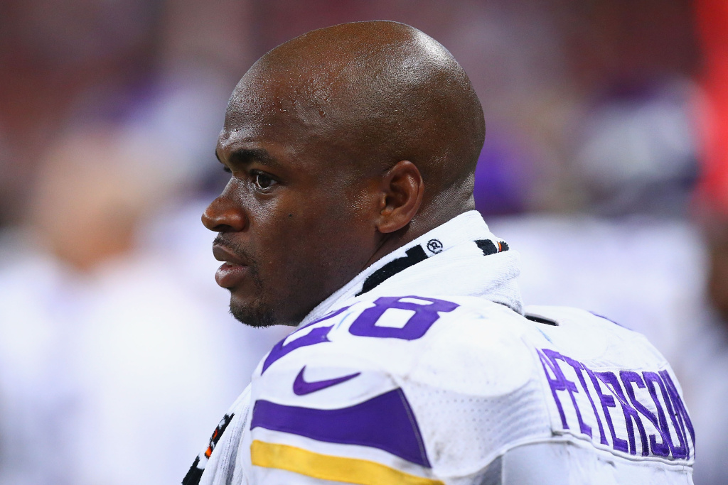 Adrian Peterson #28 of the Minnesota Vikings looks on from the sideline during a game against the St. Louis Rams at the Edward Jones Dome on September 7, 2014 in St. Louis, Missouri.  The Vikings beat the Rams 34-6.