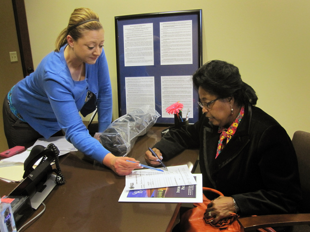 Bridgeit Vaughn (left), of the billing office at Mid State Orthopaedic, meets with Gayle Jackson-Price to discuss the costs of Jackson-Price's upcoming shoulder surgery.