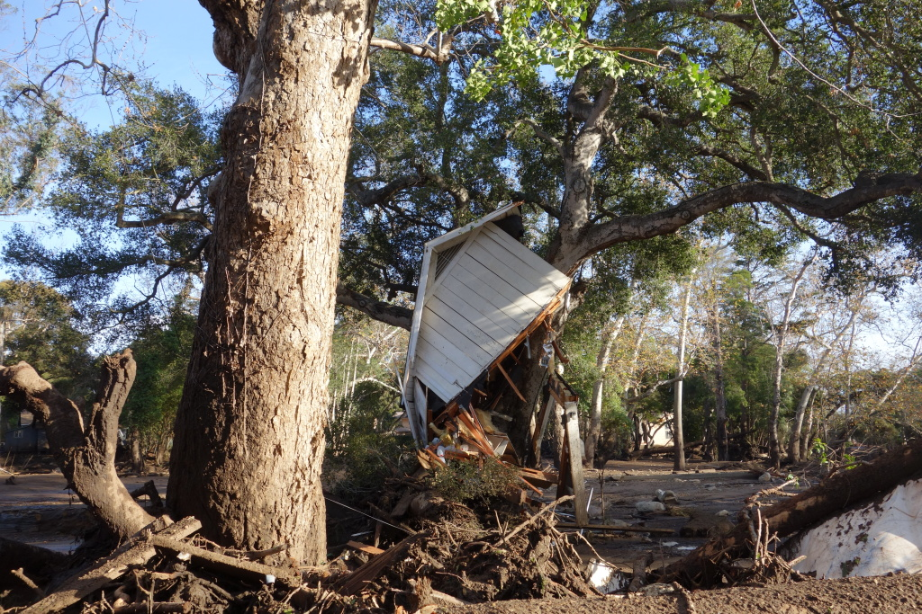 A portion of a house came to rest in a tree along Montecito Creek at East Valley Road in Montecito after flooding and a debris flow Dec. 8. The home was built in 1914 by the resident's grandfather back when he was one of the original occupants of an area known as Spanish Town.