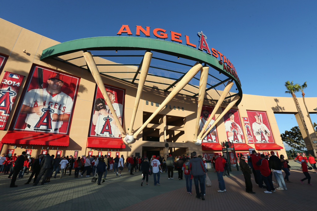 Fans enter Angel Stadium of Anaheim on Opening Day prior to the start of the game between the Seattle Mariners and the Los Angeles Angels of Anaheim on March 31, 2014 in Anaheim, California.