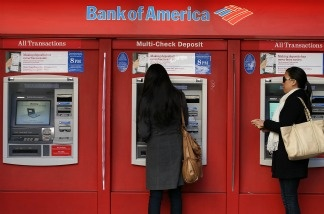Bank of America customers use an ATM on January 21, 2011 in San Francisco, California. Bank of America reported today that it has reached an agreement for an $8.5 billion settlement with a group of  investors who lost money buying mortgage-backed securities from Countrywide Financial.