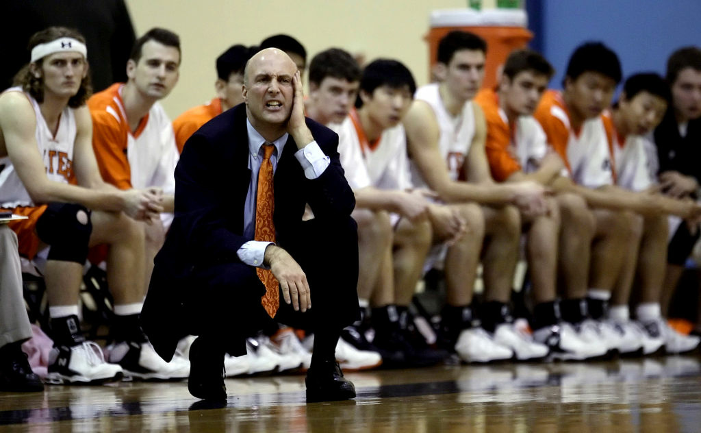 In this Feb. 1, 2006, file photo, California Institute of Technology head basketball coach Roy Dow watches his team play against Occidental College in Pasadena, Calif. The California Institute of Technology has been given a reprimand and penalties for fielding players who were academically ineligible, the NCAA announced on Thursday.