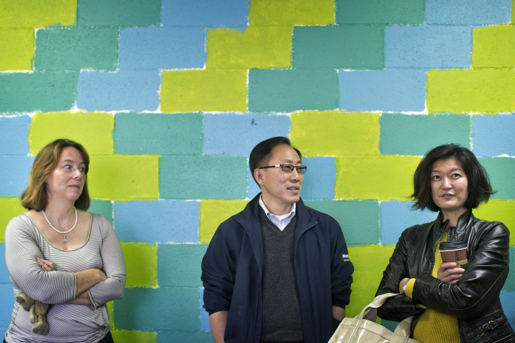 Founding parents Nancy Baca, left, Duhee Lee and Marian Chen look inside an available classroom at Pasadena Christian Church. The ad-hoc group of founding parents are calling the new school