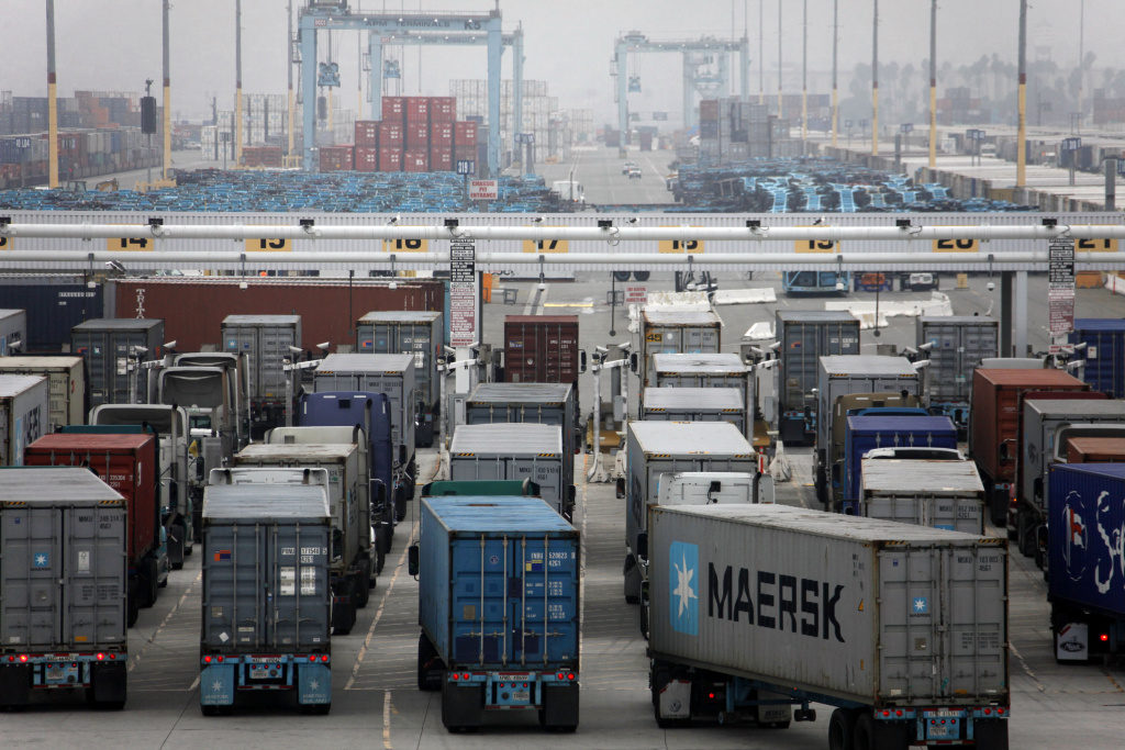 Trucks wait to be loaded at the Port of Los Angeles Wednesday, Dec. 5, 2012 in Los Angeles.