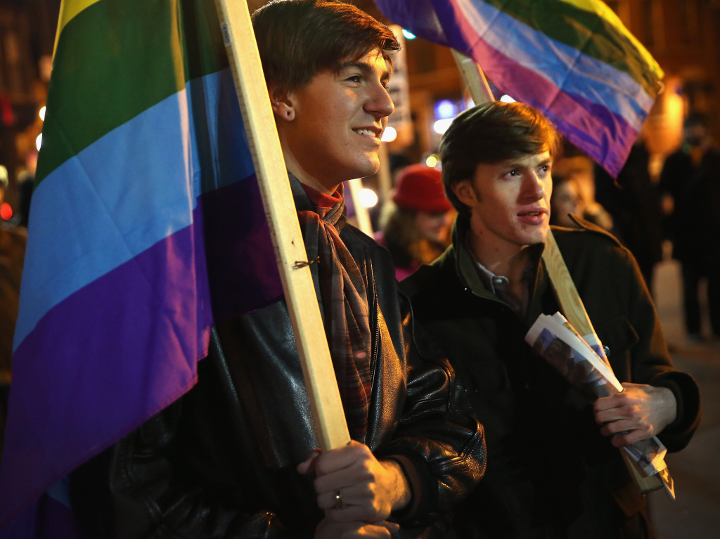 Nathaniel Iovinelli (left) and Ted Daisher join other supporters of same-sex marriage at a rally to celebrate the Illinois General Assembly's passing of the gay marriage bill on November 7, in Chicago, Illinois.