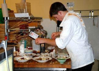 Saul Sutcher's preps for gourmet Cafe Norris meal.