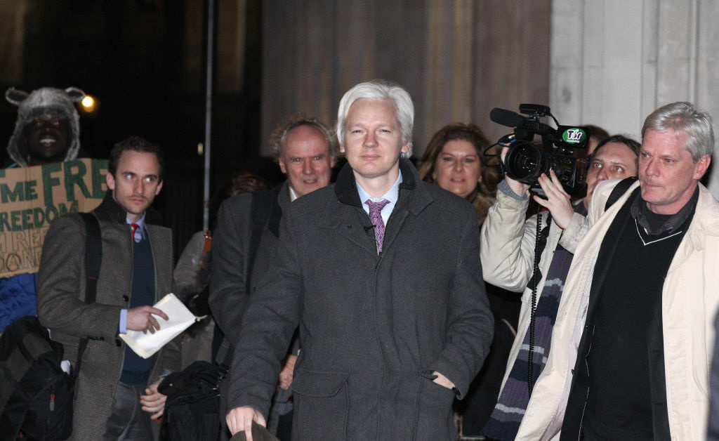 Julian Assange (C), the founder of the WikiLeaks whistle-blowing website, leaves the Supreme Court on in London, England. Assange lost the battle over his final UK appeal against his extradition to Sweden, where he is sought for questioning over alleged sex crimes.