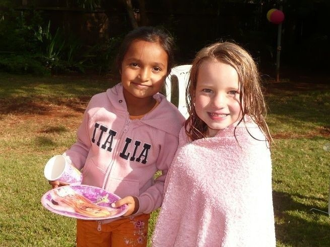 The author's daughter, right, with her friend Banita. The two girls lived next door to each other in Nairobi.