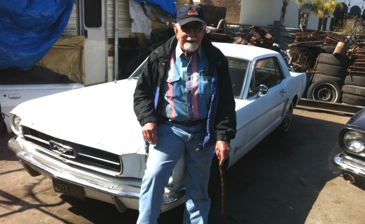 Jim Hangley in the yard of Mustangs Only!, where he's sold and restored used Ford Mustangs for 45 years.