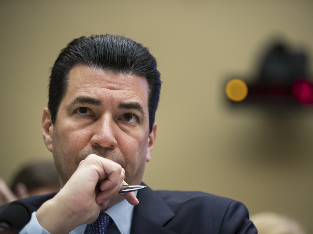 Dr. Scott Gottlieb, then commissioner of the Food and Drug Administration, testifies during a House hearing on in October 2017. In an NPR interview, Gottlieb says he doesn't expect enough demand for the COVID-19 vaccine much beyond 160 million Americans.
