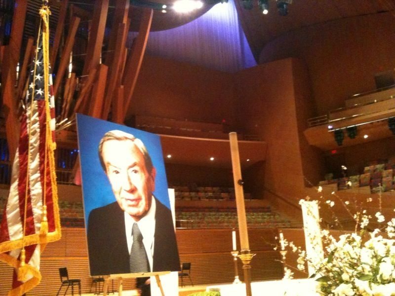 A photo of Warren Christopher sits on stage at Disney Hall, where hundreds of people gathered to pay respects to the former secretary of state and