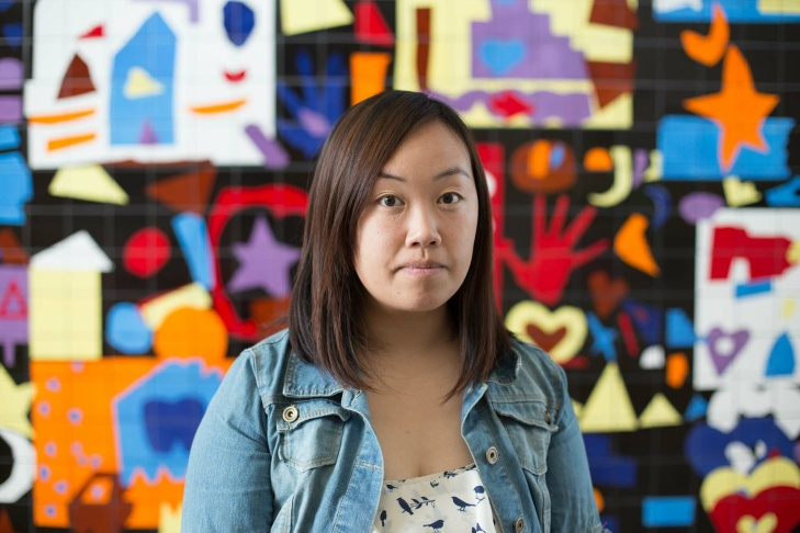 Mai Yang Vang, a Hmong community organizer, who was born and grew in Meadowview, poses in the Pannell Community Center on Friday, Feb. 12, 2016.