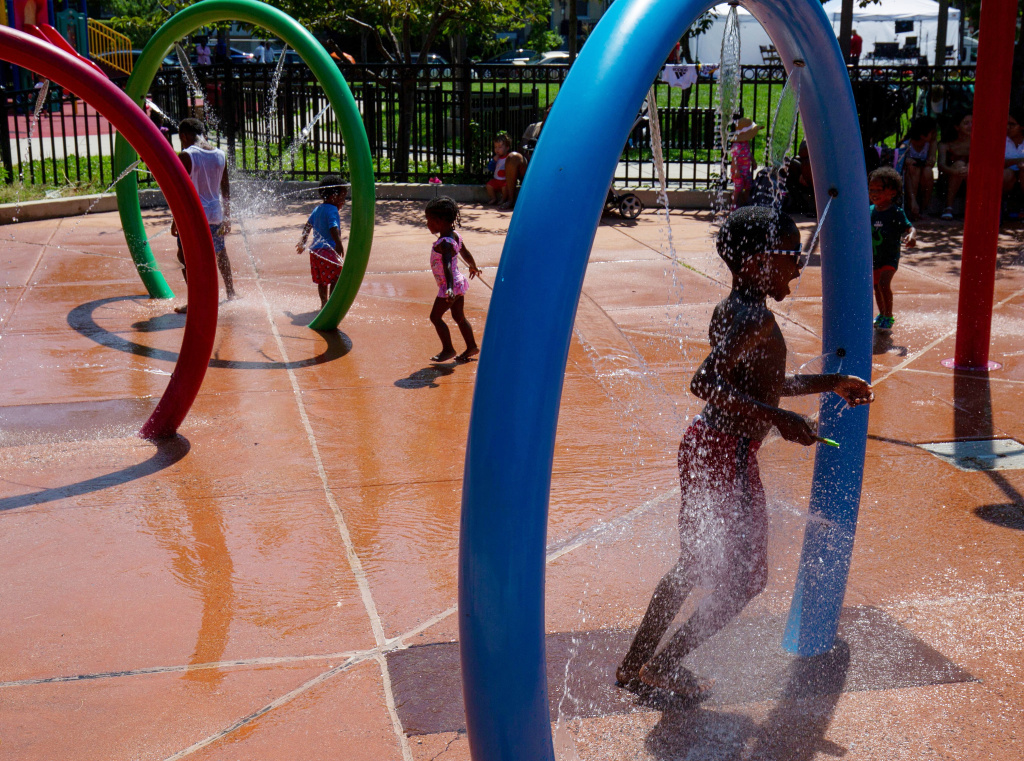 Spray parks, like this one in Washington, D.C., have become popular places for people to cool off in the heat of summer. But this year, fears over the coronavirus mean that some cities are re-evaluating whether to keep them open.